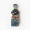 tall and skinny fairy brooch, wood and paper, blue red black