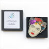 frida kahlo brooch with birds and purple flower in gift box