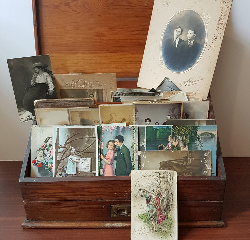 vintage postcards in wooden box