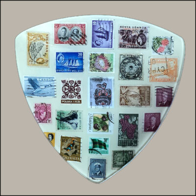 decoupage kit glass plate decorated with vintage postage stamps